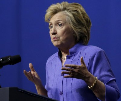 Hillary Clinton defends Clinton Foundation, says meetings were routine