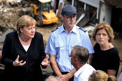 More than 180 dead in European floods; Merkel surveys 'surreal' damage