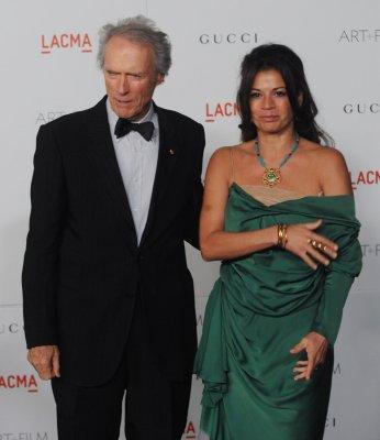 Dina Eastwood defends estranged husband Clint