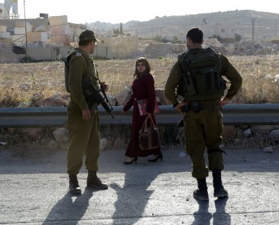 Israeli troops seeking Hamas members for teens' disappearance kill 2 Palestinians