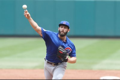 Jake Arrieta masterful as Chicago Cubs clinch home field for playoffs