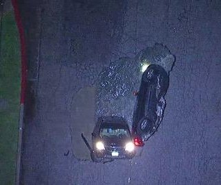 Two cars swallowed by 20-foot sinkhole in Los Angeles