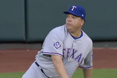 Rangers' Bartolo Colon loses perfect game in eighth inning