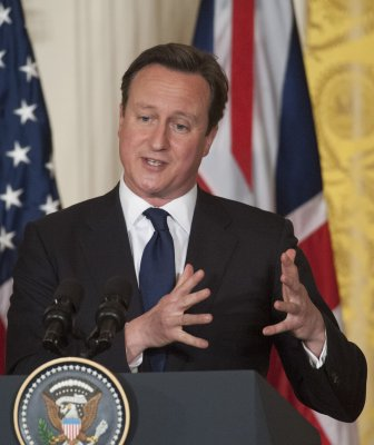 British PM David Cameron extends hand to Syrian refugees