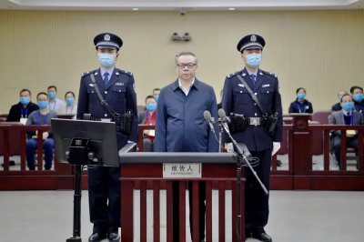 Former Chinese asset firm chief sentenced to death for taking bribes