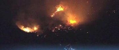 Thousands of Californians flee wildfires burning throughout the state