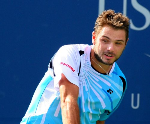 Wawrinka straight-sets Nishikori in Aussie quarters