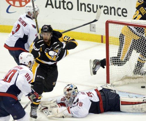 Pittsburgh Penguins eliminate Washington Capitals 4-3 in OT