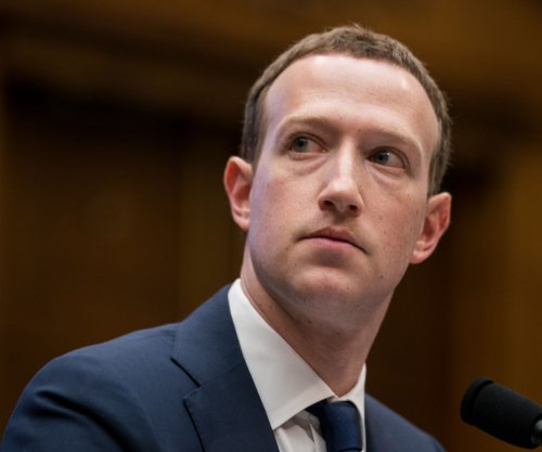Facebook investors hammer CEO Zuckerberg over scandals