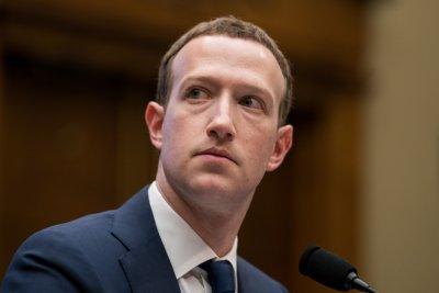 Facebook investors hammer CEO Zuckerberg over scandals