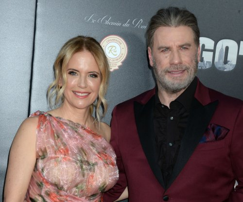 John Travolta, Kelly Preston cozy up at 'Gotti' premiere