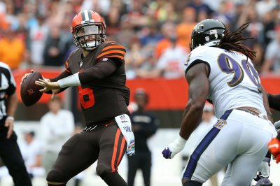 Browns cash in on Ravens' errors, win in overtime