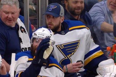 St. Louis Blues' Jake Allen gives puck to fan after gloving rocket shot on bench