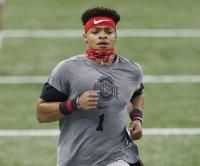 QB Justin Fields clocks fast 40-yard dash, throws 'pretty well' at Ohio State pro day