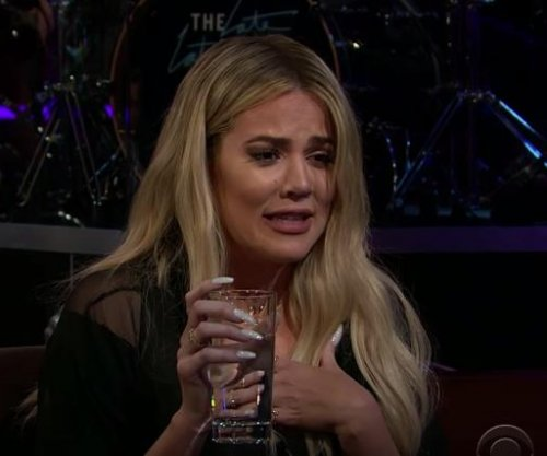 Khloe Kardashian dodges O.J. Simpson question, eats fish eye on 'Late Late Show'