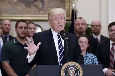 Trump travels to Iowa to talk Internet access, agriculture