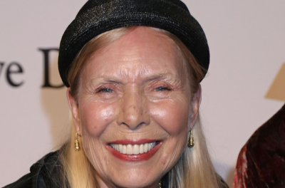 Joni Mitchell's rep disputes coma report, says she is alert and expected to recover