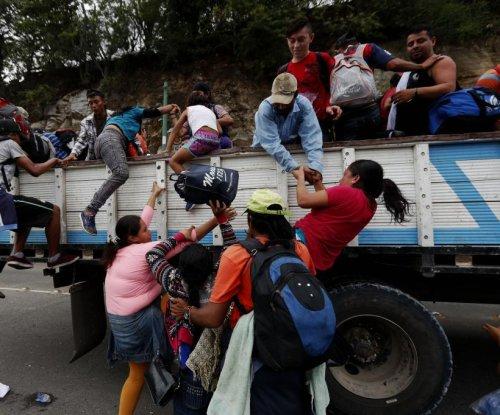 Mexico sends federal police to intercept migrant caravan at Guatemala border