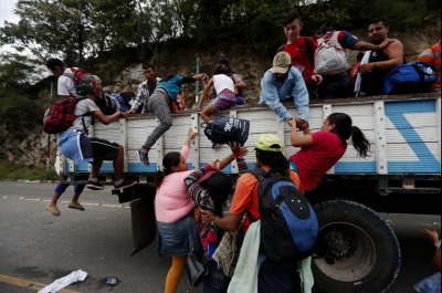 Mexico sends federal police to intercept migrant caravan at Guatemala border