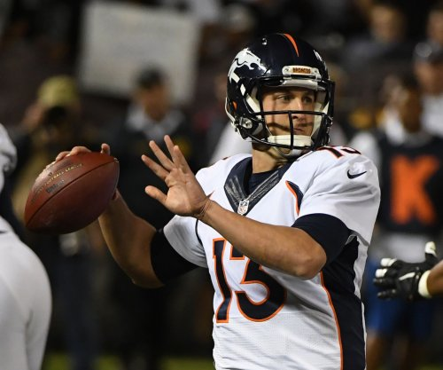 All eyes on Denver Broncos QBs Trevor Siemian and Paxton Lynch in first OTA work