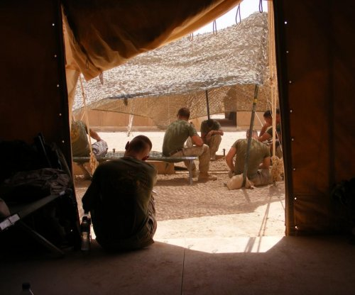 Survey of Iraq, Afghanistan veterans finds half affected by suicide
