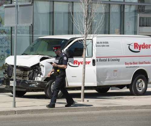 At least one killed as van strikes pedestrians in Toronto