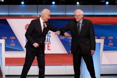 Joe Biden, Bernie Sanders address COVID-19 response in first 1-on-1 debate