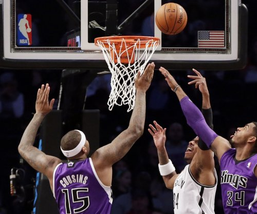 Cousins leads Kings past Minnesota
