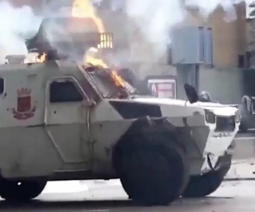 Armored military vehicle runs over Venezuelan protester
