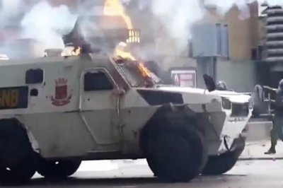 Armored military vehicle runs over Venezuelan protester