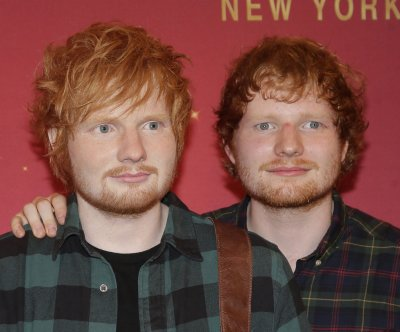 Ed Sheeran meets his wax statue at Madame Tussauds