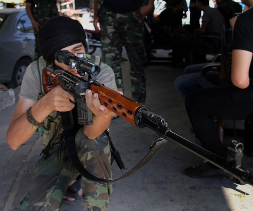 Islamic State militants war with rival Syrian rebels in Damascus