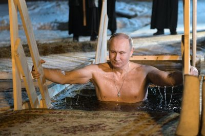 Putin takes icy plunge into lake for Epiphany celebration