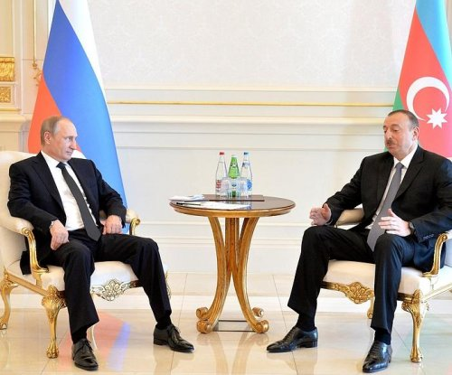 Putin courts gas-rich Azerbaijan