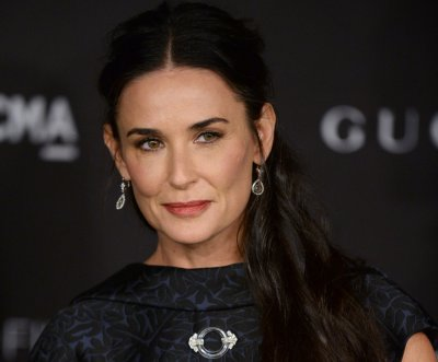 Demi Moore reportedly pays $715 a session for pet's acupuncture