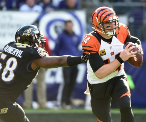 Elvis Dumervil's strip allows Baltimore Ravens to end skid versus Cincinnati Bengals