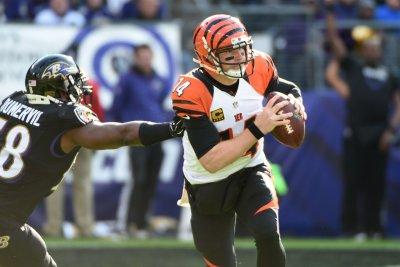 Elvis Dumervil's strip allows Baltimore Ravens to end skid versus Cincinnati Bengals