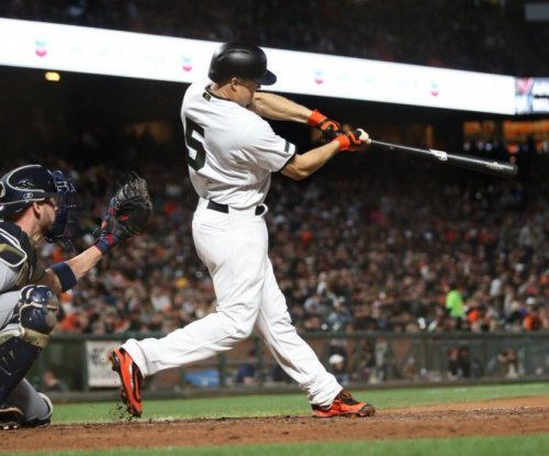 Ty Blach helps San Francisco Giants win on the mound and at plate