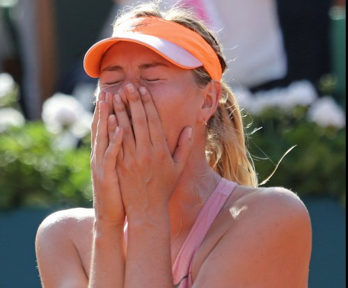 Sharapova escapes 2nd-round test at Australian Open