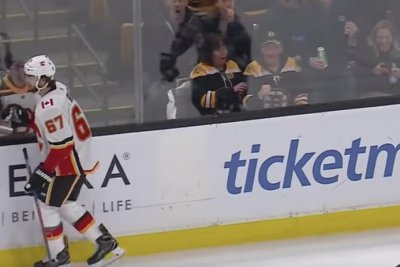 Flames' Michael Frolik skates away from fight with Bruins' Kevan Miller