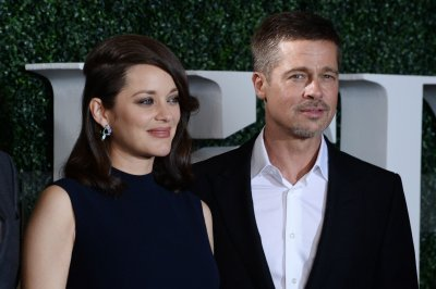 Marion Cotillard: 'Allied' sex scene with Brad Pitt was 'awkward'
