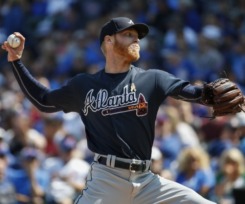First-place Braves hit home to face Giants