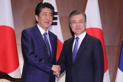 South Korea president calls for summit with Japan