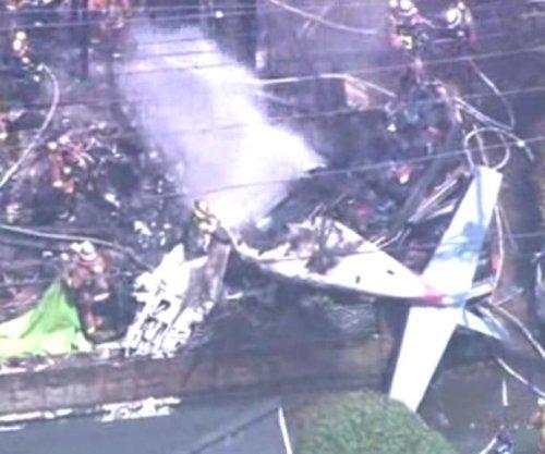Light plane crash in Tokyo residential area kills three, burns homes