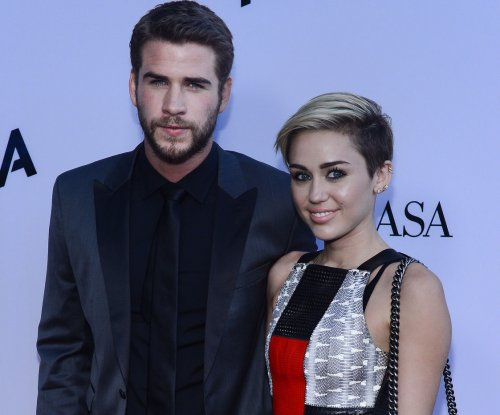 Miley Cyrus wears ring on date with Liam Hemsworth