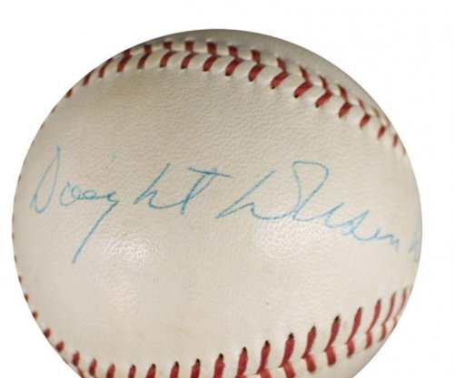 Baseballs signed by former presidents Eisenhower, Nixon up for auction