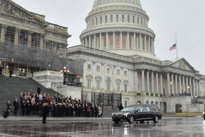 Dingell's casket escorted past U.S. Capitol after funeral in Michigan