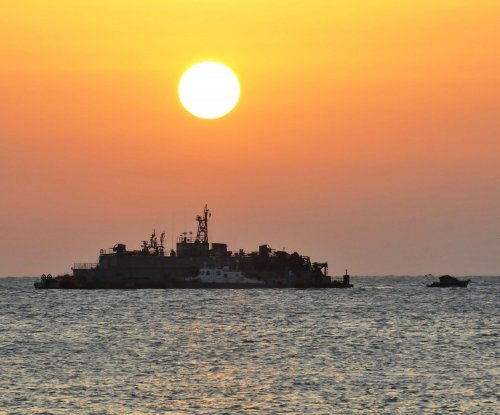 South Korea fires warning shots at two North Korea boats