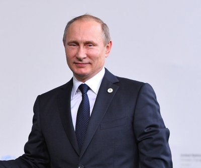 Putin merges Crimea into Russia's southern federal district