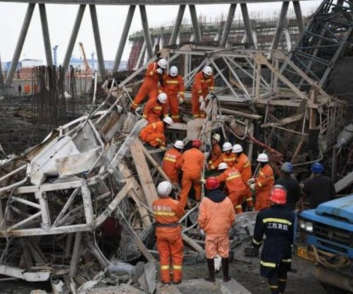 13 arrested, 74 dead in construction collapse in China